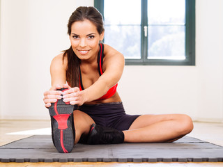 Female stretching in the gym