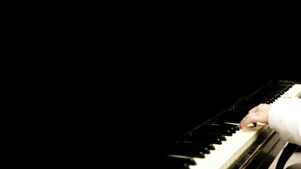 Art background: pianist hands right side shot