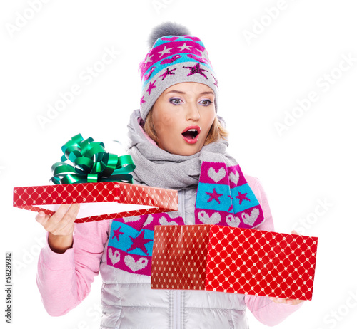 Photo of happy surprised woman with a christmas gift