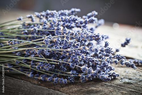Zdjęcia na płótnie, fototapety, obrazy : Bunch of lavender flowers on an old wood table