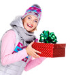 happy smiling woman giving a christmas gift