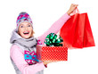 Happy woman with gifts after shopping to the new year
