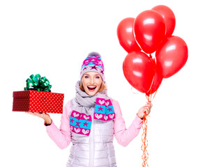 Fun happy adult woman with red gift box and balloons