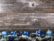 Christmas tree with baubles on wood texture