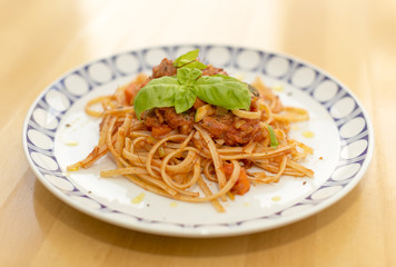 Plate with noodles and tomato sauce