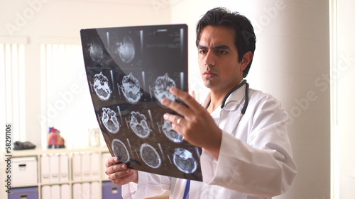 Hispanic doctor reviewing scans