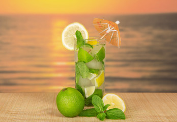 Glass about mojito, lime and mint