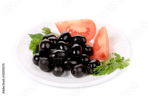 Black olives with tomatoes and parsley.