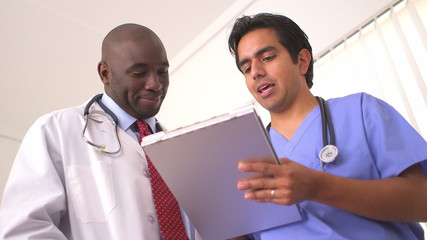 Low angle view of two doctors reviewing medical charts