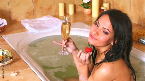Happy woman drinking champagne.