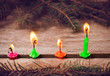 Christmas candles on wooden background