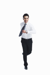 Businessman running and smiling