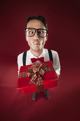 Eccentric nerdy man giving christmas present