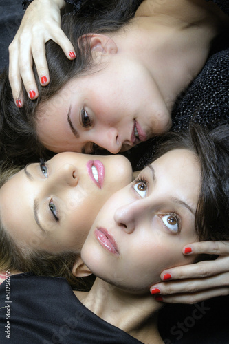 Three young beautiful girl color image