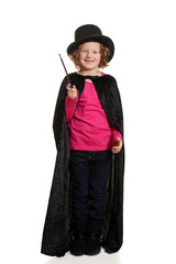 laughing little girl dressed up as magician