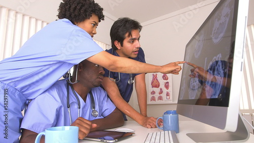 African American and Hispanic doctors using computer