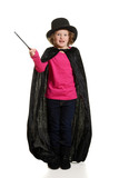 surprised girl dressed as magician motion blur on wand