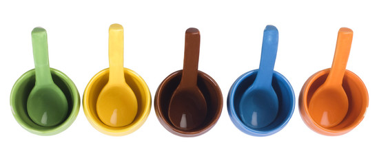 Assorted ceramic containers and soup spoons