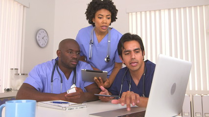 African American and Hispanic doctors using new technology toget