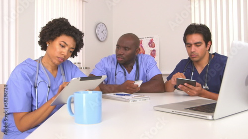 Doctors using new technology together