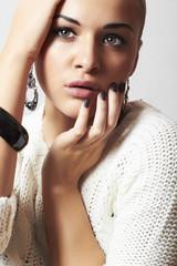 Beautiful woman in woolen dress.Jewelry and Beauty.girl
