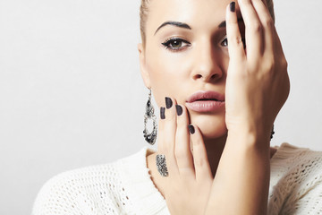 Beautiful woman in woolen dress.Jewelry and Beauty.manicure