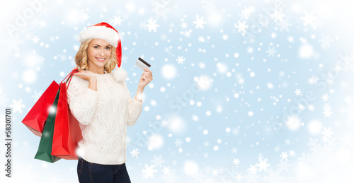 woman with shopping bags and credit card