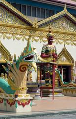Sculpture at the Thai temple Wat Chayamangkalaram on island Pena