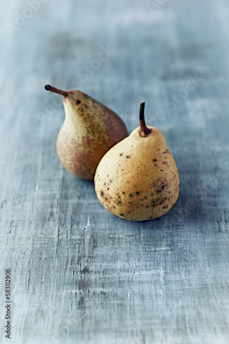 Two autumn pears on  painted wood