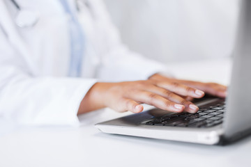 female doctor using her laptop computer