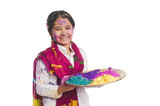 Girl holding Holi colors in a plate