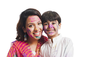 Portrait of a woman with her son celebrating Holi festival