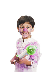 Boy celebrating Holi festival with pichkari
