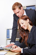 Business man looking at tablet PC of a woman