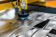 Machine cutting steel in a factory