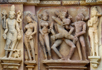 Stone carved erotic bas relief in Hindu temple in Khajuraho,  In