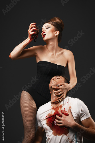 Vampire woman eating man heart