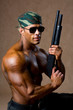 Strong athletic man with a gun