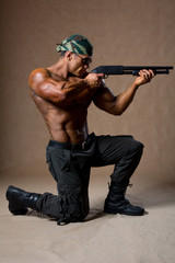 Strong athletic man with a gun. Special Forces soldier