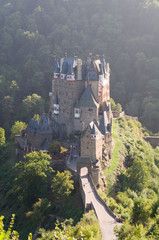 Burg Eltz is a medieval castle nestled in the hills above the Mo
