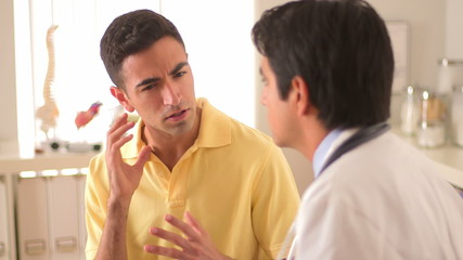 Mexican patient talking to his doctor