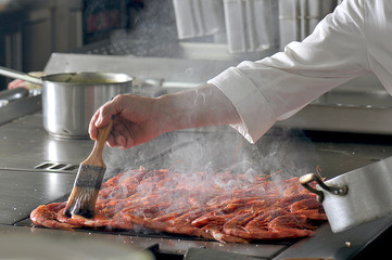 Chef in hotel or restaurant kitchen cooking
