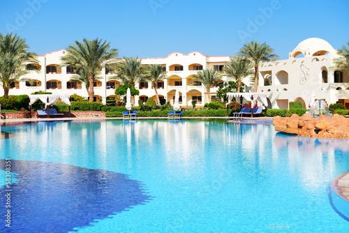 Sunbeds near swimming pool at luxury hotel, Sharm el Sheikh, Egy