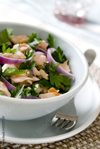salmon salad with parsley, capers and red onions.