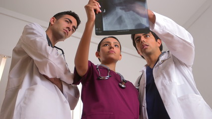 Team of Mexican doctors analyzing x-ray