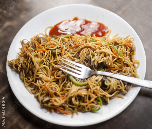 Close-up of a plate of chow mein, Tibetan Market, Delhi, India