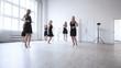 Instructor teaching dancing team.