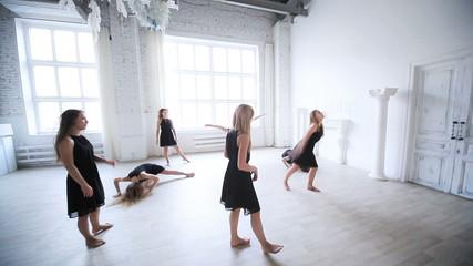Women team stretching before dancing.