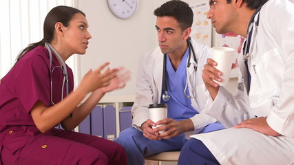 Mexican doctor talking with her colleagues