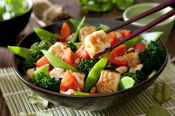 Closeup of a bowl of tofu and vegetable stir fry.